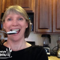 Taking a tablespoon of coconut oil for oil pulling.