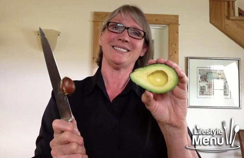 how to use a knife to take the pit of an avocado out